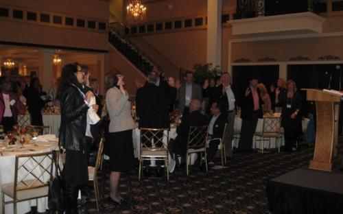 CPCUs in attendance take the CPCU Pledge